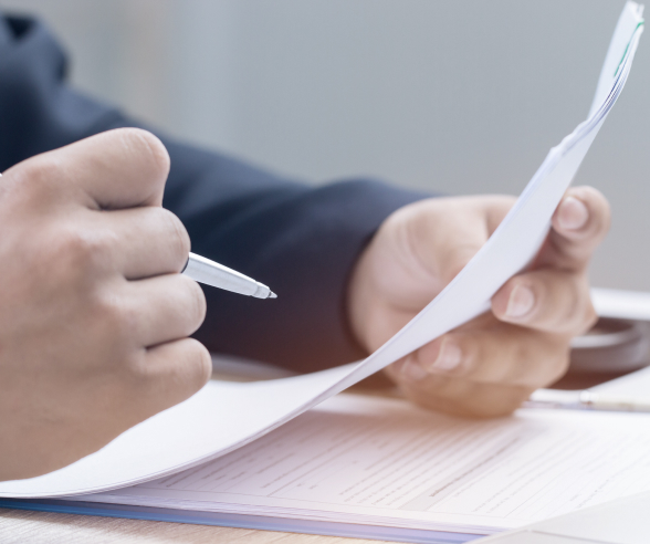 team member reading documents